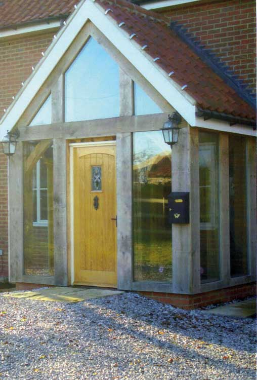 Oak porches green oak timber frame porches for your home for Modern glass porch designs